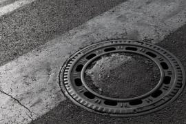 Por que as tampas de bueiro são redondas?